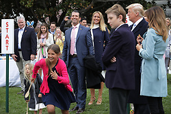 WASHINGTON, DC - APRIL 02: (AFP OUT) Donald Trump Jr. (C) and his wife Vanessa Trump attend the 140th annual Easter Egg Roll with their five children, Barron Trump, President Donald Trump and first lady Melania Trump (R) on the South Lawn of the White House April 2, 2018 in Washington, DC. The White House said they are expecting 30,000 children and adults to participate in the annual tradition of rolling colored eggs down the White House lawn that was started by President Rutherford B. Hayes in 1878. (Photo by Chip Somodevilla/Getty Images)