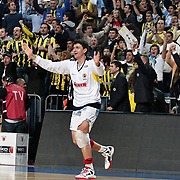 Fenerbahce Ulker's Mirsad Turkcan celebrate victory during their Turkish Basketball league derby match  Fenerbahce Ulker between Galatasaray at Sinan Erdem Arena in Istanbul, Turkey, Friday, December 30, 2011. Photo by TURKPIX