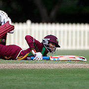 Afy Fletcher just makes her ground as the bails fly off the stumps from an attempted run out during the West Indies V New Zealand group A match at Bankstown Oval  in the ICC Women's World Cup Cricket Tournament, in Sydney, Australia on March 10, 2009. New Zealand won by 56 runs. Photo Tim Clayton