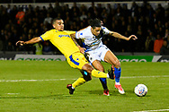 Kwesi Appiah (9) of AFC Wimbledon is unable to get his foot to the ball with a chance for goal as Daniel Leadbitter (2) of Bristol Rovers does enough to hold him off during the EFL Sky Bet League 1 match between Bristol Rovers and AFC Wimbledon at the Memorial Stadium, Bristol, England on 23 October 2018.