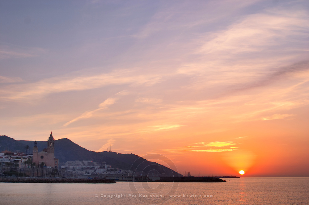 Sunrise over town and sea. Sitges, Catalonia, Spain