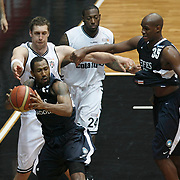 Efes Pilsen's Bootsy THORNTON (L) and Ersin DAGLI (R) during their Turkish Basketball league derby match Besiktas between Efes Pilsen at the BJK Akatlar Arena in Istanbul Turkey on Saturday 30 April 2011. Photo by TURKPIX