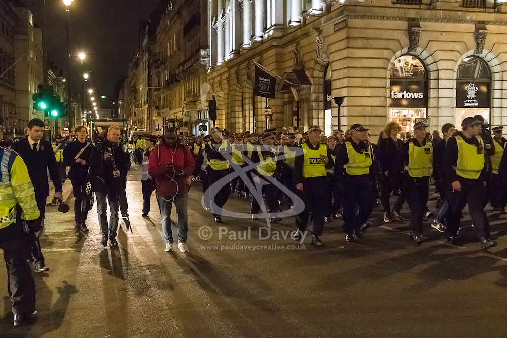 """London, November 4th 2015. Police kettle and march a group of students after thousands marched through the capital as part of their """"fight for free education,"""" protest against student debt as well as demanding """"an end to the scapegoating and deportation of international students."""" The students were released after being marched to Charing Cross Station."""