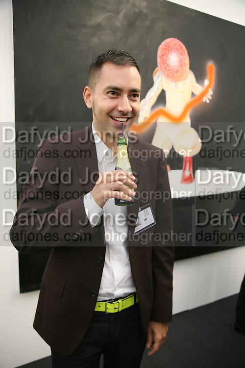 Alexandre Pollazon whose gallery exhibited work by Jason Fox ( behind) that won Belle Epoque  prize , Zoo Art Fair preview, Regents Park. 12 October 2006. -DO NOT ARCHIVE-© Copyright Photograph by Dafydd Jones 66 Stockwell Park Rd. London SW9 0DA Tel 020 7733 0108 www.dafjones.com