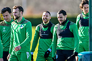 Martin Boyle (#10) of Hibernian FC (centre) is all smiles before the training session for Hibernian FC at the Hibs Training Centre, Ormiston, Scotland on 26 February 2021, ahead of the SPFL Premiership match against Motherwell.