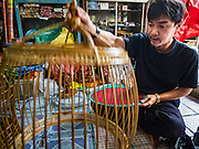 05 JANUARY 2017 - BANGKOK, THAILAND:       Sarayut Nilbai, who makes and repairs artisan birdcages, says he is the third generation of his family to live in the Pom Mahakan slum. More than 40 families still live in the Pom Mahakan Fort community. Bangkok officials are trying to move them out of the fort and community leaders are barricading themselves in the fort. The residents of the historic fort are joined almost every day by community activists from around Bangkok who support their efforts to stay. City officials pushed back their deadline and now say that they expect to have the old fort cleared of residents and construction on the new park started by the end of February 2017.      PHOTO BY JACK KURTZ