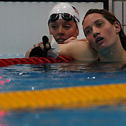 Allison Schmitt, USA, (left) and Camille Muffat, France, during the Women's 400m Freestyle heats during the swimming heats at the Aquatic Centre at Olympic Park, Stratford during the London 2012 Olympic games. London, UK. 29th July 2012. Photo Tim Clayton