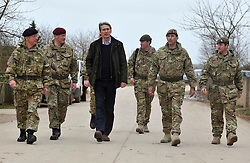 © Licensed to London News Pictures. 09/03/2012. Copedown Hill, UK. (Left to right) David Richards (black hat), Chief of Defence Staff, Philip Hammond (dark clothing), Secretary of Defence and Brigadier Doug Chalmers (second from right).  Secretary of Defence Philip Hammond visits troops who are being deployed to Afghanistan next month. The 12thMechanized Brigade (12 Mech Bde) at Copehill Down, Salisbury Plain Training Area, Wiltshire,on FRIDAY 09 MARCH 2012, as it prepares to deploy to Helmand Province, Afghanistan, on Operation Herrick 16, in the Spring of this year. The Brigade were performing a dynamic demonstration of combined Afghan/ISAF operations supported by surveillance assets and casualty evacuation capability. Tornado GR4 fast jest ground support was also displayed.. Photo credit : Stephen SImpson/LNP