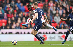Stoke City's Mame Diouf and Tottenham Hotspur's Jan Vertonghen battle for the ball