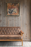 Sofa and painting inside of Pigs Inn, Bishan, Anhui Province, China