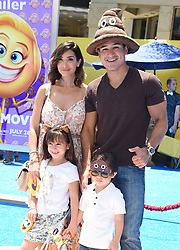 July 23, 2017 - Westwood, California, U.S. - Mario Lopez, Courtney Laine Mazza, Dominic Lopez, Gia Francesca Lopez arrives for the premiere of the film 'The Emoji Movie' at the Regency Village theater. (Credit Image: © Lisa O'Connor via ZUMA Wire)