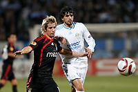 FOOTBALL - UEFA EUROPA LEAGUE 2009/2010 - 1/8 FINAL - 2ND LEG - OLYMPIQUE MARSEILLE v BENFICA - 18/03/2010 - PHOTO PHILIPPE LAURENSON / DPPI - FABIO COENTRAO (LIS) / LUCHO GONZALEZ (OM)
