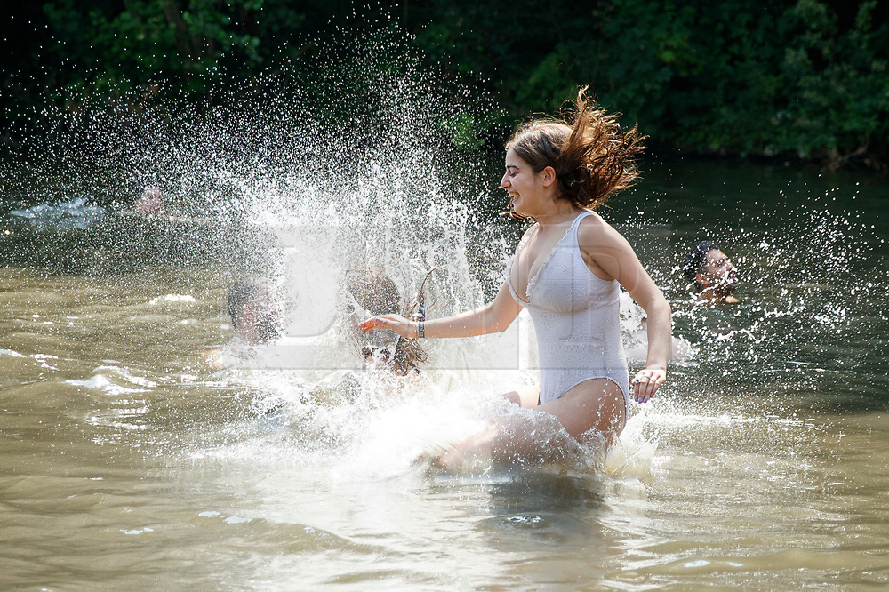 © Licensed to London News Pictures. 21/06/2017. London, UK. Jemima Salmon jumps into Hampstead Heath Mixed Bathing Pond in north London as temperatures hit 34C and makes it the hottest UK June day since 1976 on Wednesday, 21 June 2017. Photo credit: Tolga Akmen/LNP