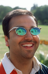 Tourist visiting the Taj Mahal; Agra; India; with the Taj Mahal reflected in his sunglasses,