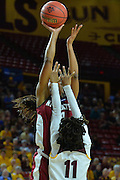 March 18, 2016; Tempe, Ariz;  New Mexico State Aggies guard Tamera William (21) tries to shoot over Arizona State Sun Devils guard Peace Amukamara (11) during a game between No. 2 Arizona State Sun Devils and No. 15 New Mexico State Aggies in the first round of the 2016 NCAA Division I Women's Basketball Championship in Tempe, Ariz. The Sun Devils defeated the Aggies 74-52.
