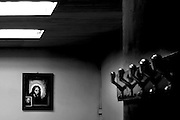 a Jesus and Padre Pio images in a recreational association