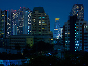 """24 MARCH 2018 - BANGKOK, THAILAND: Time exposures of Sukhumvit Road, around Soi 22 and Emporium shopping mall in Bangkok, Thailand. Made during """"Earth Hour"""" on March 24.     PHOTO BY JACK KURTZ"""