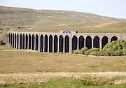 Northern Rail train crossing Ribblehead Viaduct, Yorkshire Dales national park, England, UK