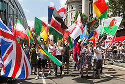 © Licensed to London News Pictures. 27/06/2015. London, UK. 220 flags of the world were carried at the start of the parade. The LGBT Pride in London Parade takes place in Central London. Photo credit: Bettina Strenske/LNP