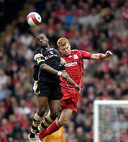 Photo: Jed Wee/Sportsbeat Images.<br /> Liverpool v Charlton Athletic. The Barclays Premiership. 13/05/2007.<br /> <br /> Charlton's Darren Bent (L) jumps with Liverpool's John Arne Riise.