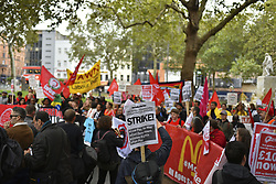 October 4, 2018 - London, United Kingdom - Protesters gathere and demonstrate during a rally in Leicester Square in support of striking fast food workers, London on October 4, 2018. Workers from fast foods franchising chains as McDonalds, TGI Fridays, Wetherspoons, UberEats and Deliveroo are walking out across the UK today asking for equal pay. (Credit Image: © Alberto Pezzali/NurPhoto/ZUMA Press)