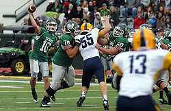 18 October 2014:  Nathan Magiera is kept at bay by Garret Laflamme and Niall Mulcahy as Donovan Laible makes a pass during an NCAA division 3 football game between the Augustana Vikings and the Illinois Wesleyan Titans in Tucci Stadium on Wilder Field, Bloomington IL