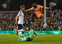 Football - 2017 / 2018 Sky Bet Championship - Fulham vs. Reading<br /> <br /> Sone Aluko (Reading FC) leaps over Marcus Bettinelli (Fulham FC) as he dives to gather the loose ball at Craven Cottage<br /> <br /> COLORSPORT/DANIEL BEARHAM