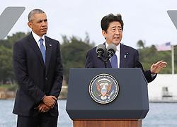 "US-Präsident Barack Obama und Japans Premier Shinzo Abe beim Gedenken an die Opfer des japanischen Angriffs auf Pearl Harbor vor 75 Jahren / 271216<br /> <br /> <br /> <br /> ***Japanese Prime Minister Shinzo Abe (R) gives a speech, along with U.S. President Barack Obama, at Pearl Harbor in Hawaii on Dec. 27, 2016, offering his ""sincere and everlasting condolences"" for those who died in the Japanese attack there in 1941.***"