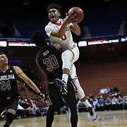 Malik Ellison, St. John's, drives to the basket defended by Chris Silva, South Carolina, during the St. John's vs South Carolina Men's College Basketball game in the Hall of Fame Shootout Tournament at Mohegan Sun Arena, Uncasville, Connecticut, USA. 22nd December 2015. Photo Tim Clayton