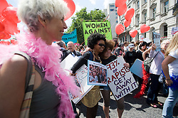 """© Ben Cawthra. 11/06/2011. London, UK. Thousands of Women take to the streets of London today (11/06/2011) to take part in Slutwalk. Slutwalk was started following remarks made by a Canadian police officer, who advised women """"to avoid dressing as sluts"""" if they did not want to be harassed Please see special instructions for usage rates. Photo credit should read Ben Cawthra"""