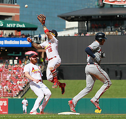 August 13, 2017 - St Louis, MO, USA - St. Louis Cardinals second baseman Kolten Wong leaps for the throw as Atlanta Braves' Freddie Freeman reaches with an infield single in the ninth inning during a game between the St. Louis Cardinals and the Atlanta Braves on Sunday, August 13, 2017, at Busch Stadium in St. Louis. (Credit Image: © Chris Lee/TNS via ZUMA Wire)