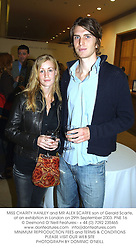 MISS CHARITY HANLEY and MR ALEX SCARFE son of Gerald Scarfe, at an exhibition in London on 29th September 2003.PNE 16