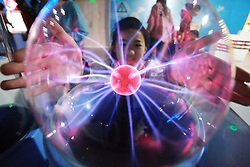 May 3, 2019 - Yangzhou, China - A child tries the plasma magic ball at Yangzhou Science & Technology Museum in Yangzhou, east China's Jiangsu Province. People visit various museums during the Labor Day holiday. (Credit Image: © Xinhua via ZUMA Wire)