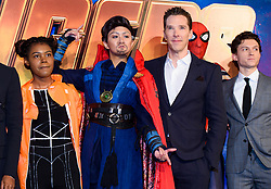 Benedict Cumberbatch (second right) and Tom Holland (right) pose with Marvel cosplayers attending the Avengers: Infinity War UK Fan Event held at Television Studios in White City, London.
