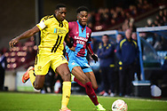 Scunthorpe United forward Ike Ugbo battles with Burton Albion forward Lucas Akins during the The FA Cup 1st round match between Scunthorpe United and Burton Albion at Glanford Park, Scunthorpe, England on 10 November 2018.