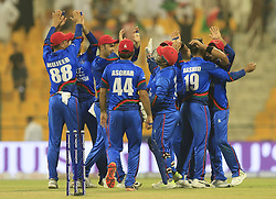 September 18, 2018 - Abu Dhabi, United Arab Emirates - Afghanistan cricketers celebrate their win over Sri Lankan cricket team during the 3rd cricket match of Asia Cup 2018 during the 3rd cricket match of Asia Cup 2018 between Sri Lanka and Afghanistan at the Sheikh Zayed Stadium,Abu Dhabi, United Arab Emirates. 09-17-2018. (Credit Image: © Tharaka Basnayaka/NurPhoto/ZUMA Press)