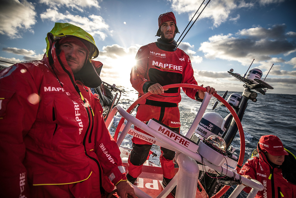 Leg 02, Lisbon to Cape Town, day 19, on board MAPFRE, a good sunset after three claudy days. Blair Tuke stearing, Tamara Echegoyen at the aft pedestal and Antonio Cuervas-Mons holding the main sheet . Photo by Ugo Fonolla/Volvo Ocean Race. 23 November, 2017.