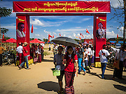 01 NOVEMBER 2015 - YANGON, MYANMAR: Girls walk past the entrance to the NLD's last election rally of the 2015  election in the Yangon suburbs Sunday. Political parties are wrapping up their campaigns in Myanmar (Burma). National elections are scheduled for Sunday Nov. 8. The two principal parties are the National League for Democracy (NLD), the party of democracy icon and Nobel Peace Prize winner Aung San Suu Kyi, and the ruling Union Solidarity and Development Party (USDP), led by incumbent President Thein Sein. There are more than 30 parties campaigning for national and local offices.    PHOTO BY JACK KURTZ
