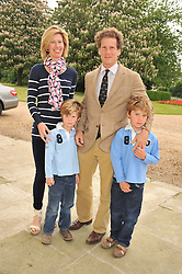 JOHN & NICOLA HARRISON and their sons L-R FREDDIE & SAM at a Summer Drinks Party hosted by The Friends of The Royal Marsden, Chelsea held at The Royal Hospital Chelsea, Royal Hospital Road, London SW3 on 14th June 2012.