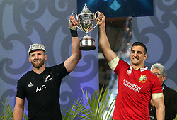 British and Irish Lions' Sam Warburton and New Zealand's Kieran Read lift the Series Trophy after the series is drawn during the third test of the 2017 British and Irish Lions tour at Eden Park, Auckland.