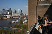 View from the terrace at Tate Modern gallery of contemporary art in London, England, United Kingdom. Tate Modern is based in the former Bankside Power Station in Southwark and is one of the largest museums of modern and contemporary art in the world. As with the UKs other national galleries and museums, there is no admission charge for access to the collection displays, which take up the majority of the gallery space. The redevelopment of the space was undertaken by architects Herzog & de Meuron.