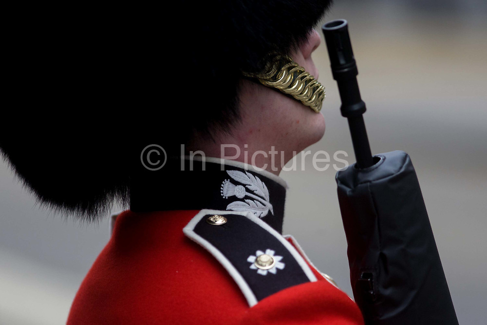 A guardsman stands to attention before the funeral of Margaret Thatcher. Draped in the union flag and mounted on a gun carriage, the coffin of ex-British Prime Minister Baroness Margaret Thatcher's coffin travels along Fleet Street towards St Paul's Cathedral in London, England. Afforded a ceremonial funeral with military honours, not seen since the death of Winston Churchill in 1965, family and 2,000 VIP guests (incl Queen Elizabeth) await her cortege. Margaret Hilda Thatcher, Baroness Thatcher (1925- 2013) was a British politician who was thePrime Minister of the United Kingdomfrom 1979 to 1990 and theLeader of the Conservative Partyfrom 1975 to 1990, the longest-serving British Prime Minister of the 20th century and the only woman to have held the office to date.