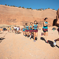 Shiprock girls varsity cross country team warms up before the NMAA District 1-4A Championship meet at Red Rock Park Saturday, Nov. 2 in Church Rock. Shiprock placed first as a team.