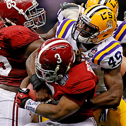 Jan 9, 2012; New Orleans, LA, USA; LSU Tigers defensive end Barkevious Mingo (49) tackles Alabama Crimson Tide running back Trent Richardson (3)during the first half of the 2012 BCS National Championship game at the Mercedes-Benz Superdome.  Mandatory Credit: Derick E. Hingle-US PRESSWIRE