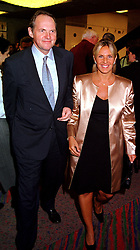 The EARL OF DARTMOUTH and MISS TITIKIA PORFYRATOS, at a reception in London on 23rd October 2000.OIC 47