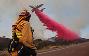 June 20, 2016 - Duarte, California, U.S. -Upland Fire Capt. JOE BURNA watches as a tanker drops fire retardant to stop a wildfire from jumping over Highway 94 near Potrero on Monday. <br /> ©Exclusivepix Media