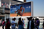 Area around Stratford in East London, home to the 2012 Olympic Games. Large scale sponsorship advertisement showing Usain Bolt for majoy corporate sponsor, VISA.