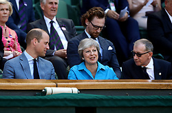 The Duke of Cambridge and Theresa and Philip May in the royal box on centre court on day thirteen of the Wimbledon Championships at the All England Lawn Tennis and Croquet Club, Wimbledon.