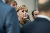 14 NOV 2018, POTSDAM/GERMANY:<br /> Angela Merkel, CDU, Bundeskanzlerin, waehrend einer Praesentation des HPI im Rahmen der Klausurtagung des Bundeskabinetts, Hasso Plattner Institut (HPI), Potsdam-Babelsberg<br /> IMAGE: 20181114-01-042<br /> KEYWORDS; Kabinett, Klausur, Tagung, muede, müde