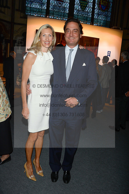 """COUNT & COUNTESS ALESSANDRO GUERRINI MARALDI at a private view to view """"The Coronation Theatre: Portrait of Her Majesty Queen Elizabeth II"""" painted by Ralph Heimans held at Westminster Abbey, London on 12th September 2013."""